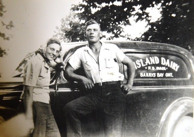 Teresa and Raymond Senior in front of the Island Dairy milk truck in 1939.